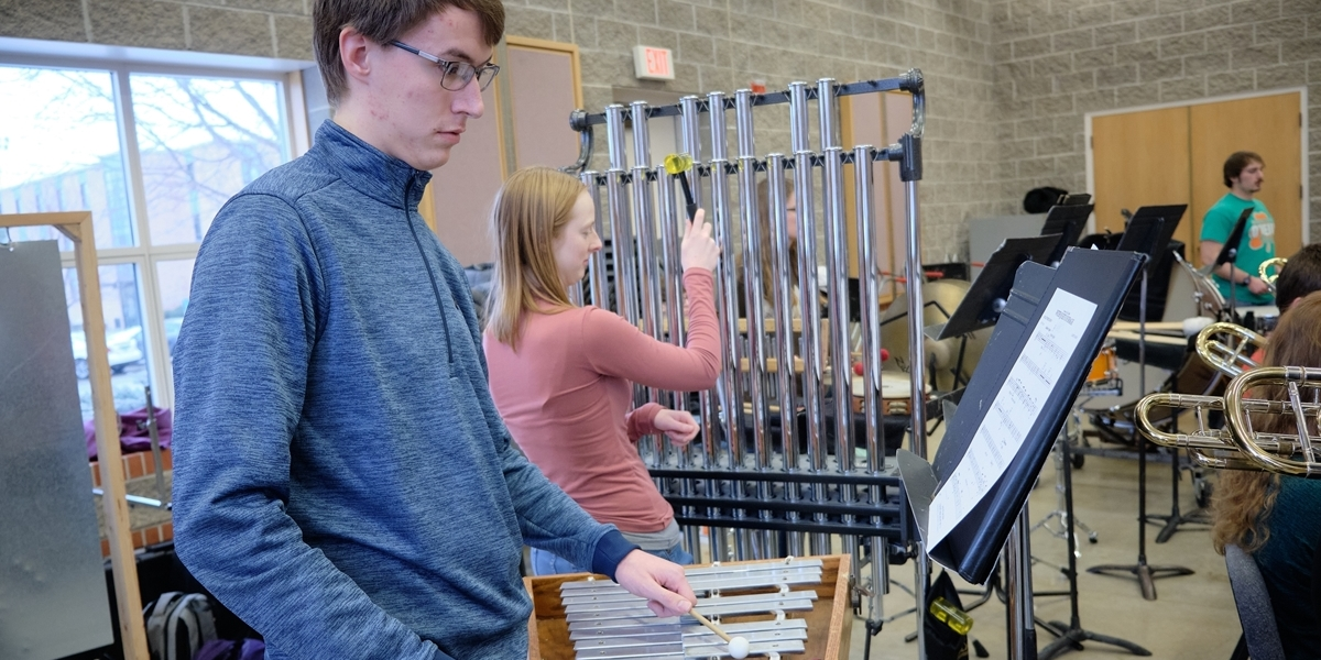 Symphonic Band percussion players rehearse.