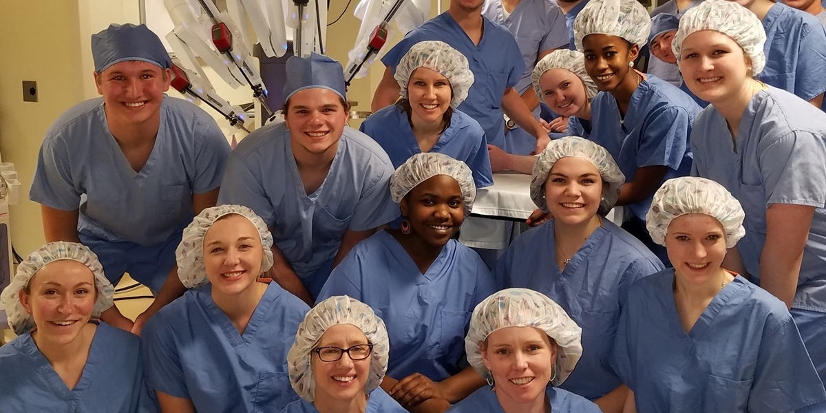 Northwestern students wear scrubs while on a field trip to Avera Hospital