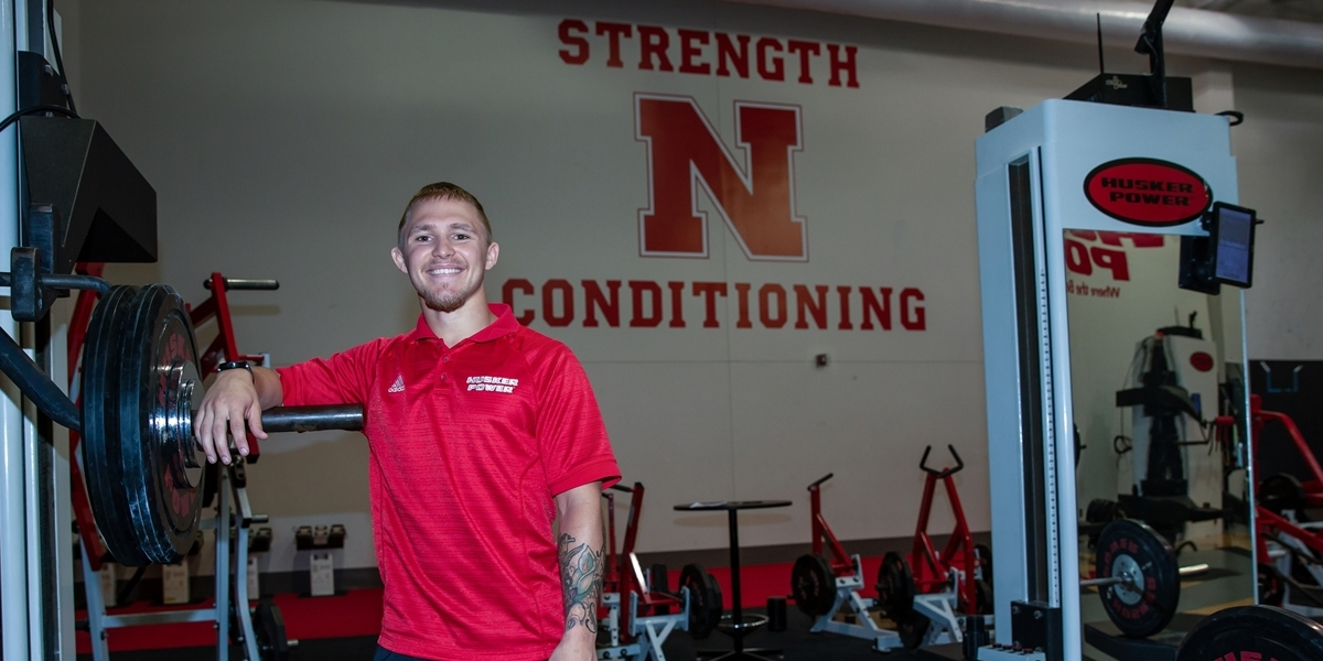 A student poses during his strength and conditioning internship.