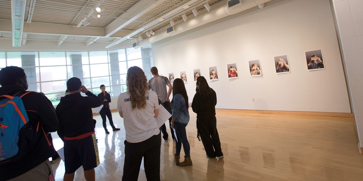 Northwestern students view an exhibit in the Te Paske Gallery.