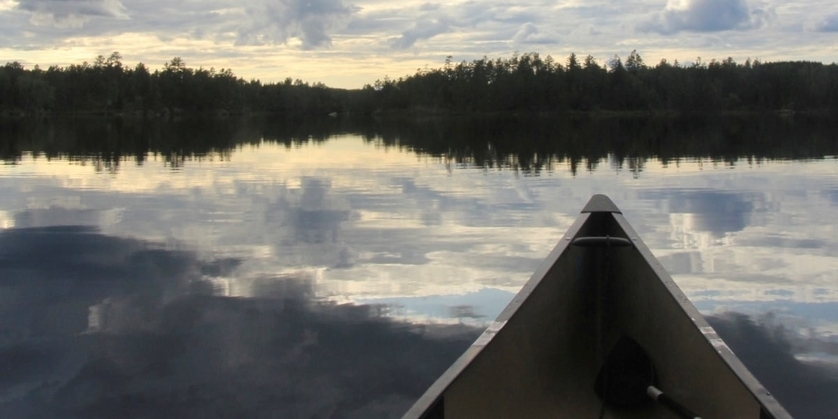 A Northwestern student overlooks the vista from their canoe during the Portage trip.