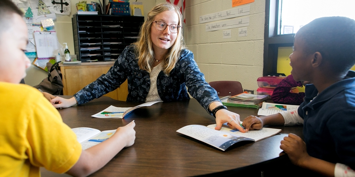 A Northwestern student teacher helps students during her experience in Denver.