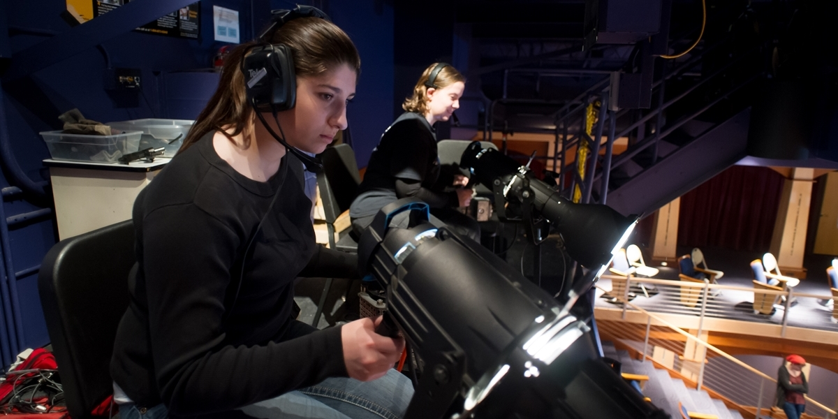 Northwestern students run lights during a theatre production.