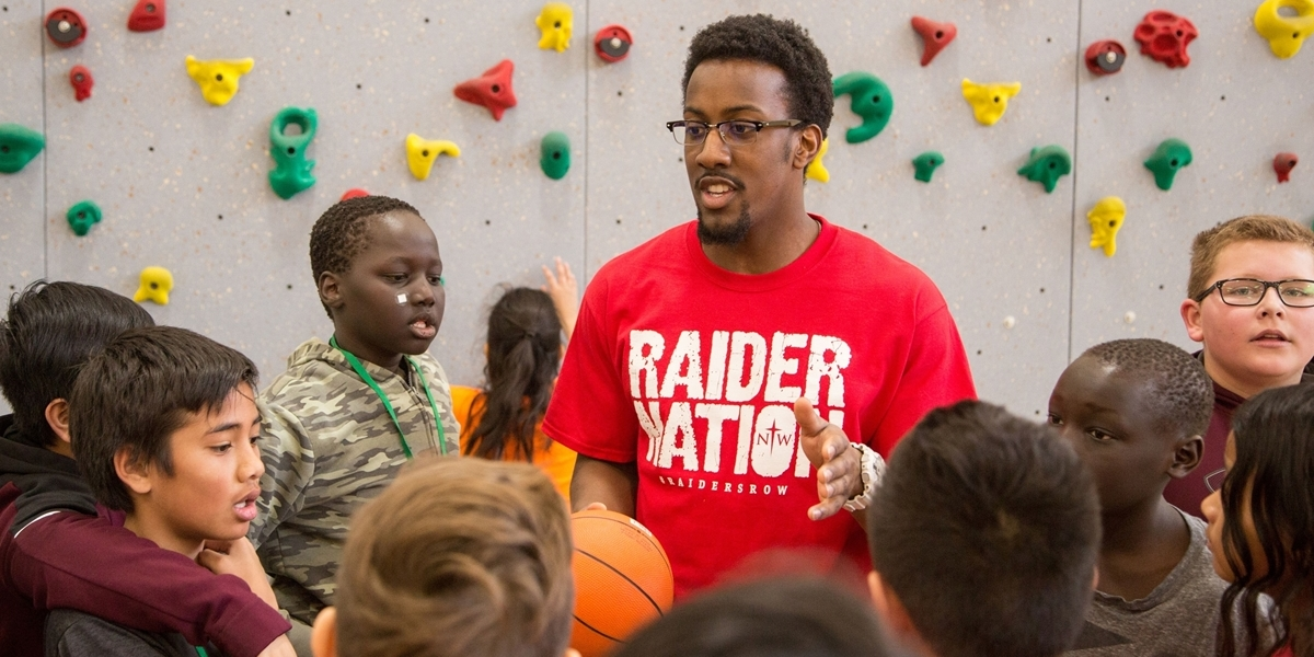 A Northwestern College alum leads a physical education class in Storm Lake, Iowa.