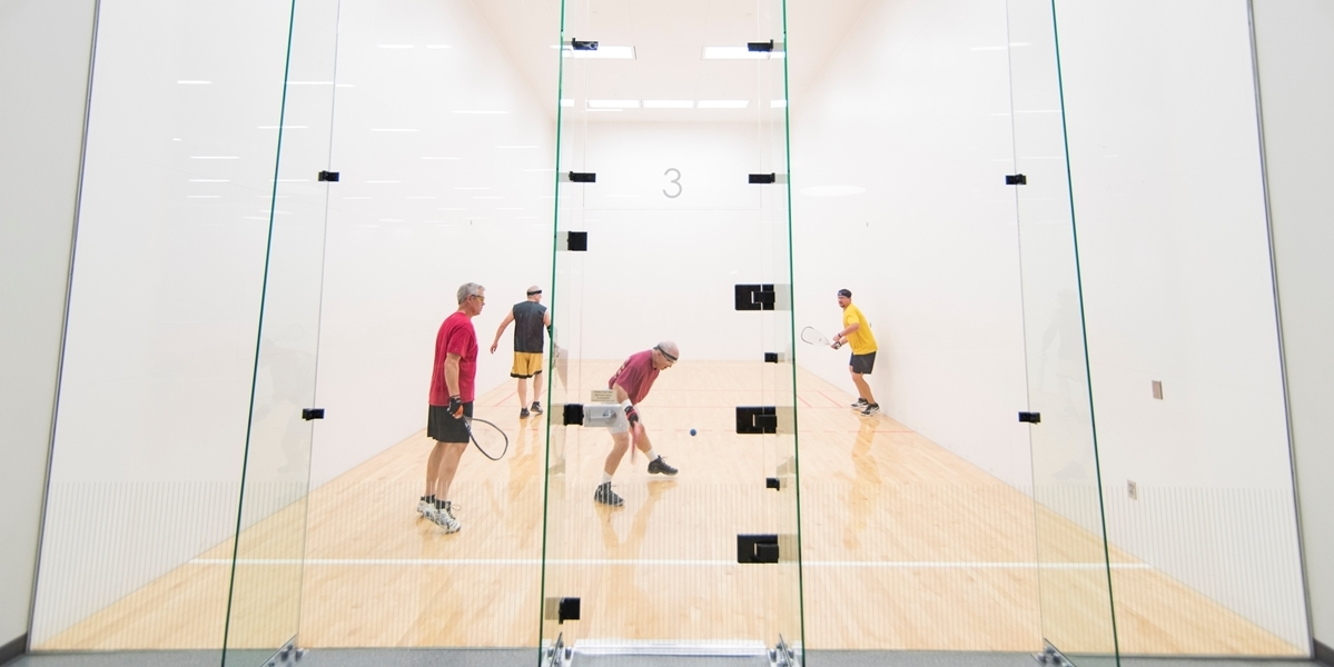 Students play racquetball in the DeWitt Physical Fitness Center.