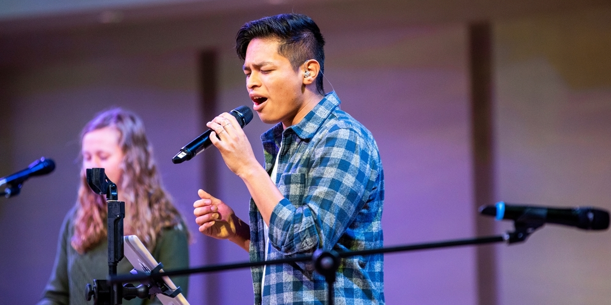 A student leads worship during a Northwestern chapel service.