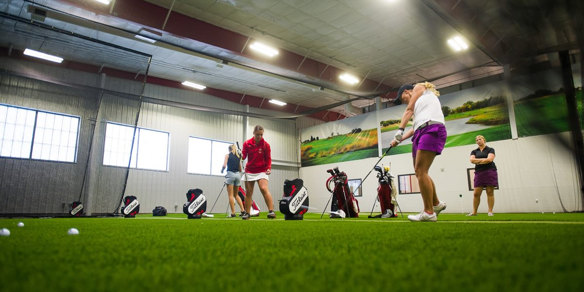 Northwestern students practice their golf swing in the Juffer Athletic Fieldhouse.