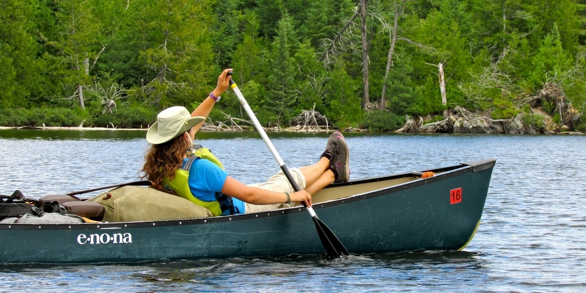 A Northwestern student relaxes in a canoe during Portage.