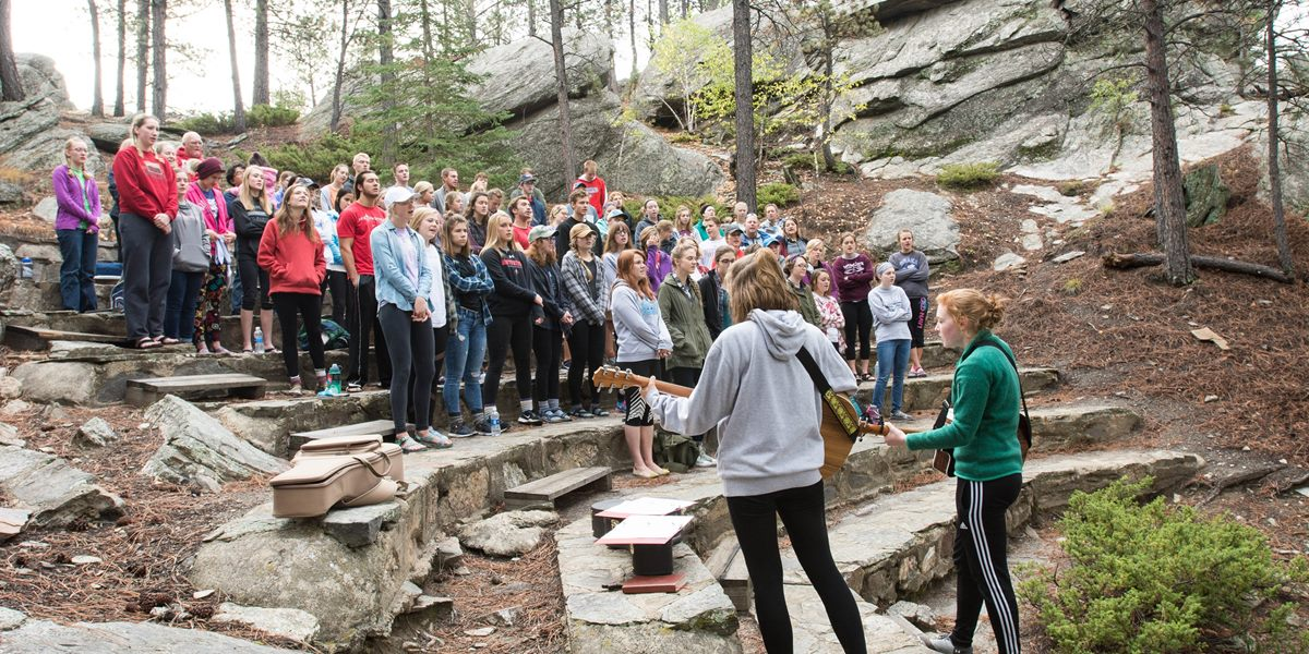Northwestern College students worship in the Black Hills during a fall retreat.