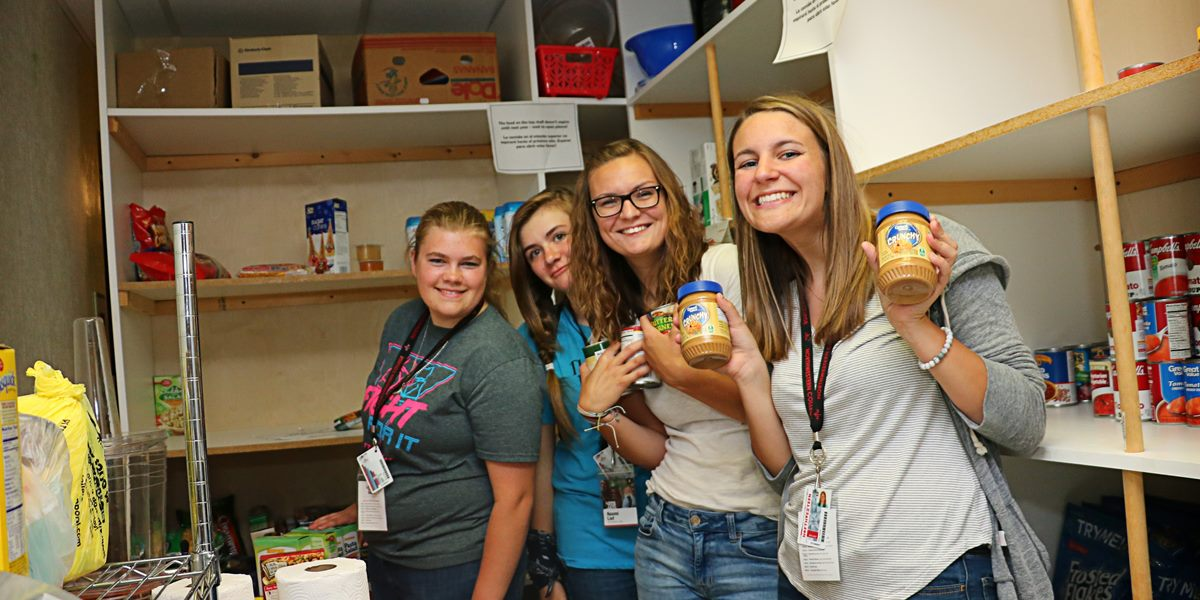 Students help stock a local food bank.