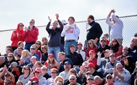 Fans cheering at the Red Raider football game