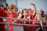 Kids cheering at football game