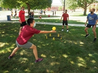 New students playing games on the green.