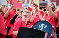 Red Raider Athletic Band member playing a drum